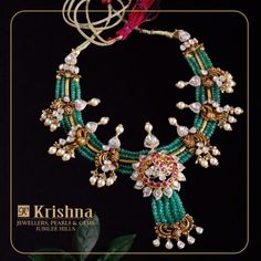 Peacock themed alluring necklace made in Nakshi Paachi workmanship with uncuts diamonds Rubies Southsea pearls and beaded in Emeralds perfectly complement the contemporary jewellery.For Inquiries contact on our What's App 01 May 2019 Bead Jewellery, Gems Jewelry, Pearl Jewelry, Indian Jewelry, Beaded Jewelry, Beaded Necklace, Diamond Jewellery, Saree Jewellery, Necklace Set