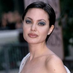 ANGELINA JOLIE - 1998 The pixie-cropped actress won her first Golden Globe for TV biopic George Wallace; the following year she would receive a second statuette for her role in Gia.