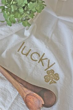 One Gold Lucky Shamrock Flour Sack Towel  Whether you want to celebrate St. Patricks Day or add some lucky sparkle to your kitchen, this towel will brighten up your day. I hand printed my original Lucky Shamrock design in metallic gold on a 100% cotton flour sack towel. Flour sack towels are soft and absorbent with a vintage look. They get softer with use. Because I use eco-friendly, nontoxic ink, you can feel good about choosing a towel that is safe for your family and the environment. Use…