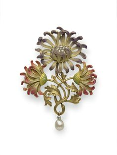 AN ART NOUVEAU DIAMOND AND ENAMEL CHRYSANTHEMUM BROOCH, BY PLISSON & HARTZ -  Centering upon a lavendar and cream enamel chrysanthemum with an old mine-cut diamond cluster pistil, bordered by two pink, cream and green enamel chrysanthemums, joined by textured gold stems and leaves, suspending a pearl and diamond drop, mounted in 18k gold, circa 1895