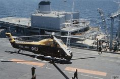 A Westland Wessex HAS.1of No 820 Naval Air Squadron on board HMS EAGLE. In the background, a Royal Fleet Auxiliary large fleet tanker of the 'Ol' Class is alongside refuelling the aircraft carrier