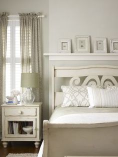 Whimsical headboard, picture rail with vintage egg drawings. Joyce Bruce Design.