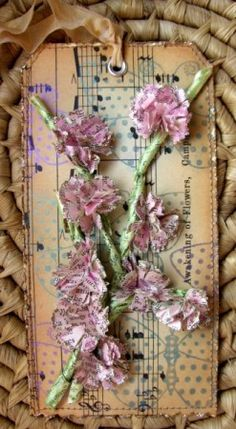 Lisa Pace rocks! Love the flowers made from book pages.