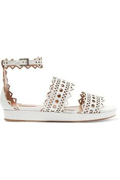 Alaïa's sandals come in a fresh and pristine white hue that's perfect for summer. Expertly hand-finished in Italy, this pair is crafted from leather and detailed with the label's signature laser-cut pattern. The cushioned wedge heel ensures all-day comfort.
