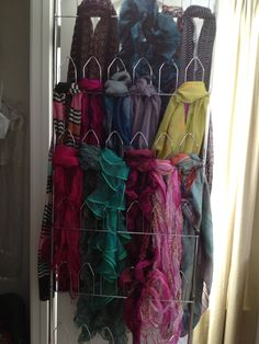 Repurposed shoe organizer for scarves.