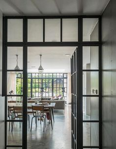love the dark metal window frames