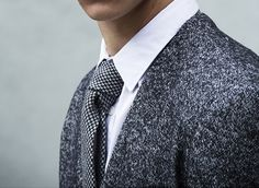 Love the tie with the coat. Big pattern on small pattern