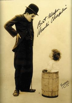 Photo signed & inscribed by Chaplin. Rarely seen sepia photo by Hartsook, c. 1915.