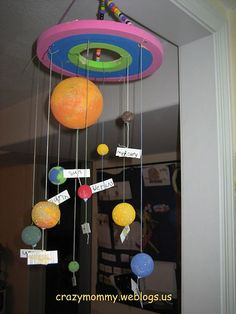 Simple Solar System mobile craft made from recycled circular foams, yarn and foam balls in assorted sizes. Space the planets according their distance to the Sun and attach labels on the yarn to name the planets. Solar System Projects For Kids, Solar System Crafts, Space Projects, Space Crafts, School Projects, Art Projects, Science For Kids, Art For Kids, Science Art