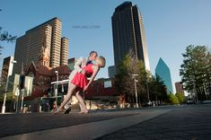 Winspear Opera House Engagement Photo Session - stylish couple dancing in the street with Dallas Downtown in the background - photo by Vanja D Photography www.vanjad.com