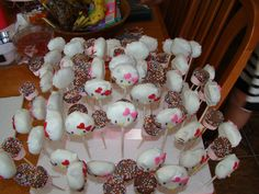 Hello Kitty Party Cake Pops. This was my first time making cake pops so it came out okay.  Her ears didn't come out because I used the small chocolate chips instead of the regular size.  I have perfected my cake pop techniques. The other pops are chocolate covered strawberry flavor marshmallows. Her party was after Valentines and Easter so I had plenty time to stock up on sprinkles.