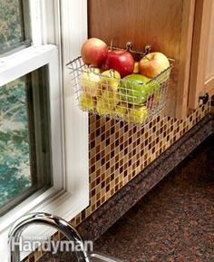 Keep fruit off the counter.  Find a nice wire basket at a discount or office supply store and hang it at the end of an upper cabinet near your kitchen sink. Clever!