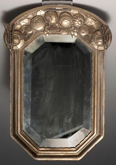 Art Deco wall mirror, c1928. Bronze, brass sheet, cut plate glass. Style of Paul Follot or Louis Suë.  36 x 24.5 cm.