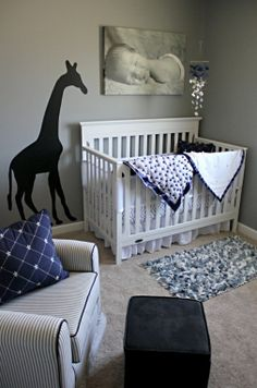 Simple but cute baby nursery- i would make the giraffe orange....needs more color