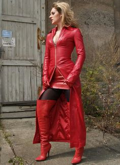 Red leather coat-dress over leather skirt, thigh boots and gloves
