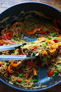 Stir Fried Singapore Noodles with Garlic Ginger Sauce - fresh, simple, delish.... (just sub veg broth for the chicken broth for vegetarian...)