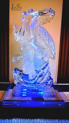 Pelican ice sculpture delivering a baby!  (not a stork)