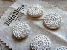 handmade crochet buttons, these would make great beading bases