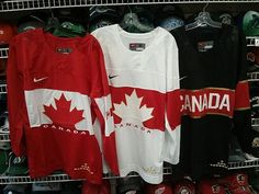 A photograph of what is alleged to be all three Team Canada hockey sweaters  for the 2014 Sochi Olympic Winter Games has gone viral on social media  websites. 381131813