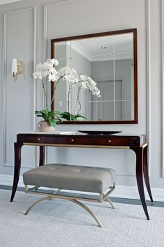 Refined Foyer. Designed by Elizabeth Metcalfe Interiors Design Inc. www.emdesign.ca - featuring a Thomas Pheasant Table and Barbara Barry Bench Mirror, all from Baker Furniture More