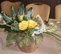 What an elegant flower centerpiece for a golden anniversary party at Salt Creek Grille.