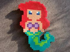Check out this item in my Etsy shop https://www.etsy.com/listing/229284651/a-bit-geeky-magnet-ariel-the-little