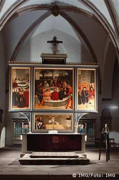 Reformatiealtaar   Lucas Cranach de Oude.         Marien- of Stadskirche Wittenberg.