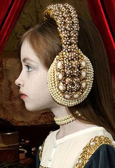 A side view of Adriana Duque's headphones...