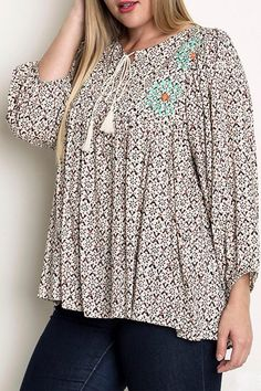 Super comfortable top with a fun pattern. Loose fitting sleeves and a tie neckline. Never compromise on style and still be comfortable! Pairs great with skinny jeans or denim shorts. Not sheer and has no lining.    Flower Power Top by Umgee USA. Clothing - Tops Washington