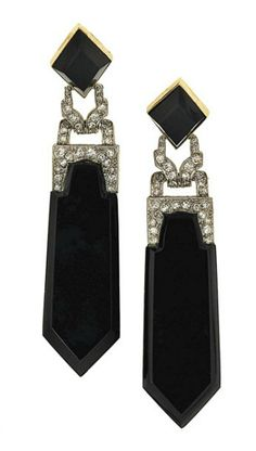 A pair of onyx and diamond pendent earrings   Each kite-shaped onyx surmount suspending an onyx drop to a millegrain-set single-cut diamond articulated openwork connecting link, 7.8cm long. Art Deco or Art Deco style