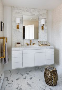 Clean white bathroom with gold accents, transitional bathroom