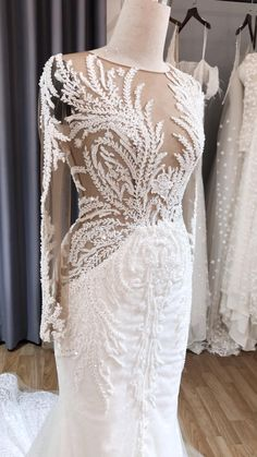 A daring, ultra-sexy, and sparkling wedding dress featuring an illusion beading bodice with sheer fitted long sleeves for fabulous brides. Perfect for a summer wedding ceremony on the beach! Mermaid Wedding Dress With Sleeves, Illusion Neckline Wedding Dress, Sheer Wedding Dress, Fit And Flare Wedding Dress, Applique Wedding Dress, Custom Wedding Dress, Dream Wedding Dresses, Mermaid Bridal Gowns, Long Sleeved Wedding Dresses