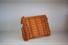Perfect summer time clutch, with crossbody strap included!