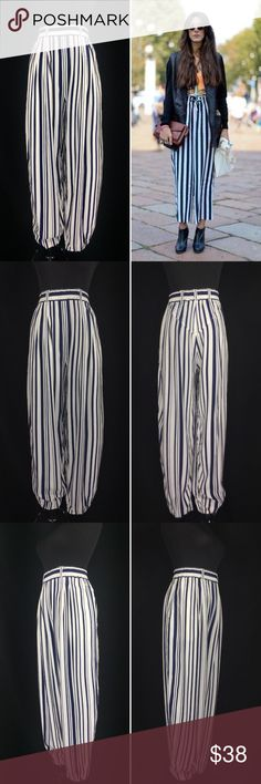 "Vintage 90's EXPRESS Vertical Stripe Harem Pants Vintage EXPRESS Women's Large Blue & White Vertical Stripe Harem Pants. Great vintage condition. Thick banded elastic waist with belt loops. Hip pockets. Harem style tapered legs. Some minor color transfer on white. Labeled a Large. Measurements of the item in inches when flat: Waist: 15"" Rise: 16"" Hips: 26"" Inseam: 26.5"" cuff: 6"" Length: 39"" Feel free to contact me with any questions you may have. Please take a look at my other unique…"