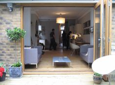 Sliding timber doors lead from the house into the garden. Timber Door, Victorian House, House Extensions, Home Appliances, Doors, Garden, House Appliances, Victorian Home, Puertas