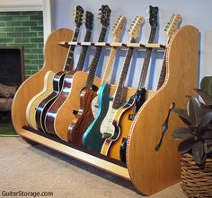 The Session™ Deluxe Wood Multiple Guitar Stand is perfect for your living room or studio! Available in 5 and 7 guitar stand versions. Save space, consolidate your collection, and keep it safe and organized. No need to purchase a bunch of individual stands.
