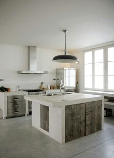 Concrete, stainless steel and reclaimed wood kitchen in France