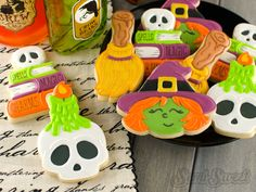 Decorate a custom cookie cutter in the design of skull candle cookies. Picture and video tutorial will help guide you through the decorating process.