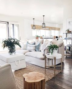 Bright + white + airy + potted plants scattered throughout. This is a refreshing home, clean and open and ready to be lived in and run through with a toddler :)