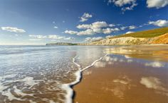 The National Trust invites you to help one of Britain's most celebrated poets, Dr John Cooper Clarke, complete the 'Nation's Ode to the Coast'. Share your memories and love of the coast using  (Image: Compton Bay, Isle of Wight) Best Uk Beaches, Isle Of Wight Beach, Travel Competitions, Holiday Places, Seaside Resort, Island Beach, Lake District, Beautiful Islands, Landscape Photos