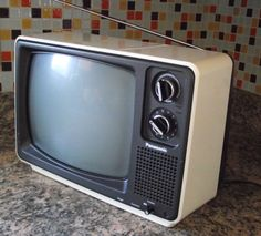 Panasonic Television Space Age 1970s Style Black and White Portable TV Made in 1980 Model TR-1202TA Solid State Christmas Gift. $65.00, via Etsy.