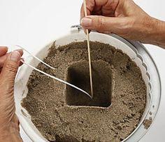 Kerzen machen im Sand