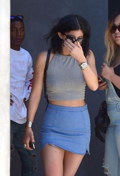 Kylie Jenner style is killer. Jean skirt with (maybe suede?) crop.