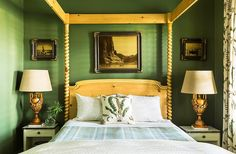 "The deep green provides a beautiful contrast to the natural-wood four-poster bed and the ornate table lamps. The paint color is  Benjamin Moore's ""Alligator Alley."""