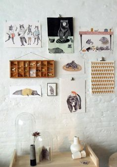 "clever ways to ""clip"" and ""stick"" art to a wall."