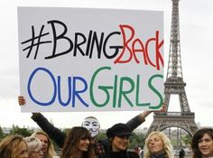 #BringBackOurGirls | Paris France 2014 | A person holds a poster during a Paris rally at the Trocadero, in front of the Eiffel Tower, to support the release of the kidnapped girls | ©Remy De La Mauviniere /AP