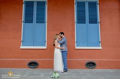 Bride and groom kissing in front of an old New Orleans home in the French Quarter in New Orleans