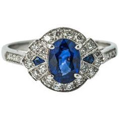 Sapphire Diamond Gold Cluster Ring .......... $3,726