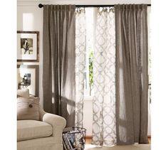 Sheer curtains under drapes