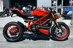 Red Ducati Streetfighter with a unique rim color scheme